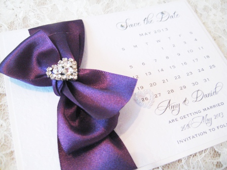 Save the date wedding cards with purple ribbon and diamante heart