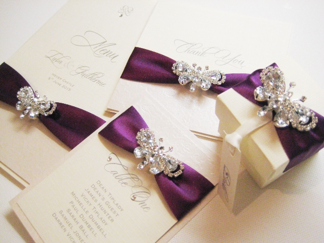 Butterfly wedding stationery with purple ribbon