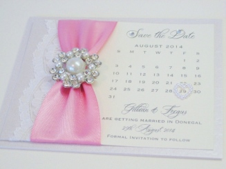 Save the date card with pearl brooch