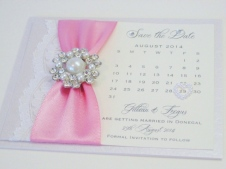 Luxury save the date card with lace and brooch