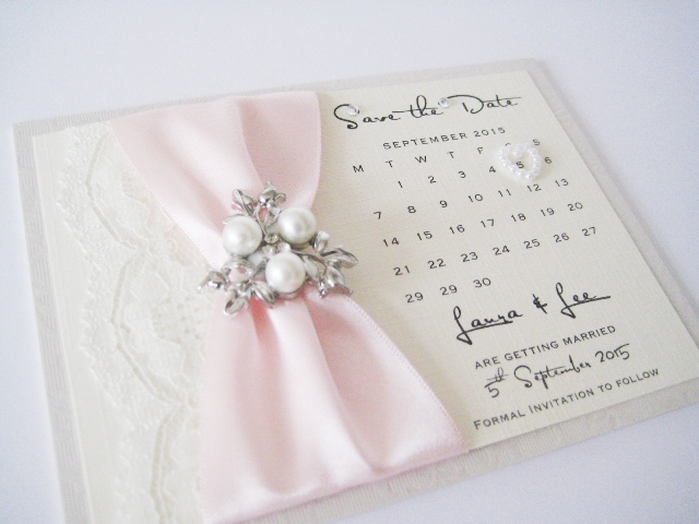 Luxury save the date cards with pearl brooch and lace