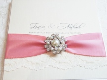 lace wedding invitation with dusky pink ribbon