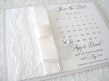 save the date cards in ivory with lace