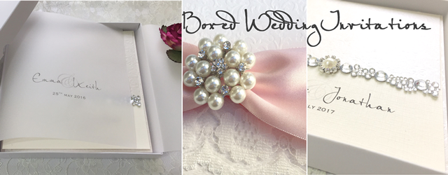Beautiful boxed wedding invitations with brooches