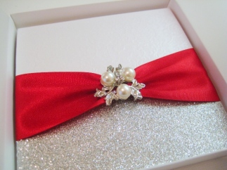 Red and Silver invitation with pearl brooch