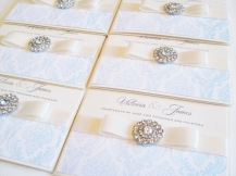 Dusky blue wedding invitations with vintage crystal brooch