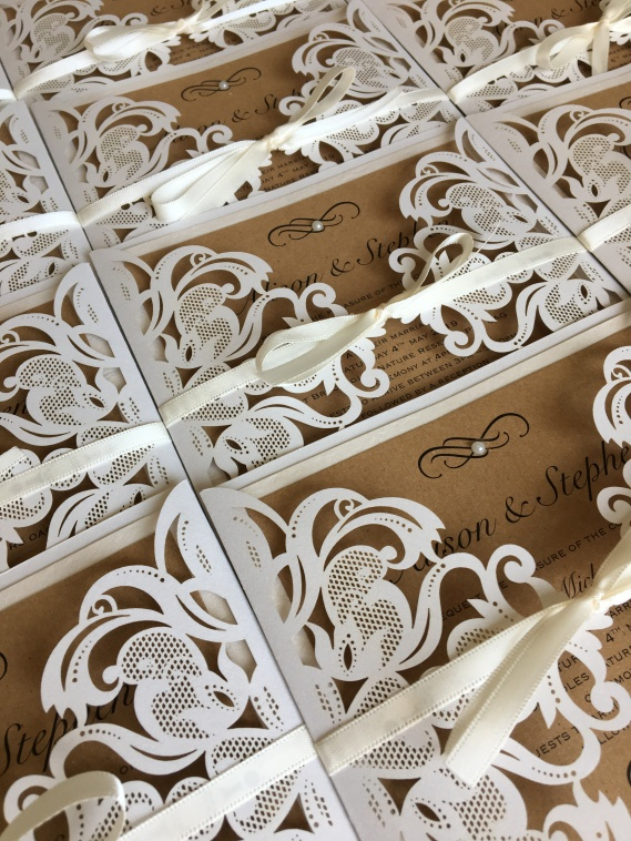 Rustic laser cut wedding invitations