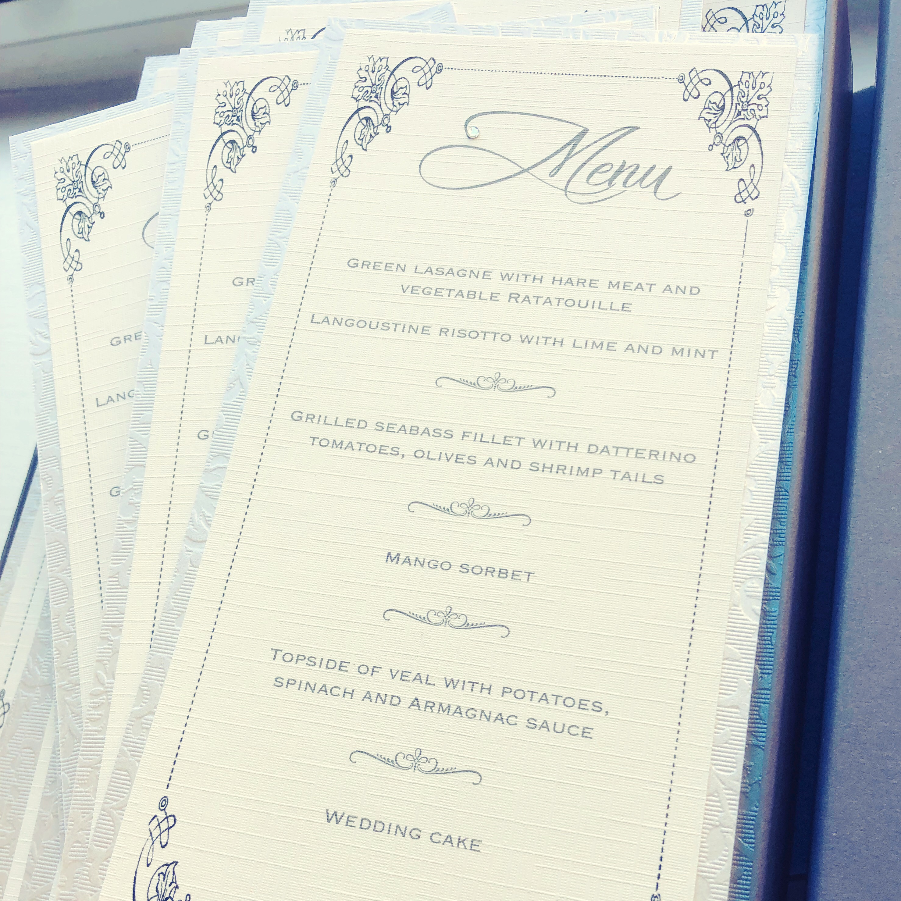 Simple breakfast menu in ivory with embossed border
