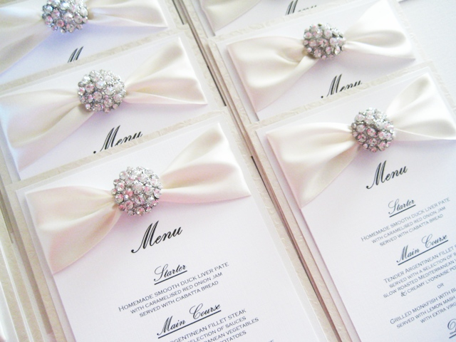 Champagne crystal wedding breakfast menu in white and ivory.